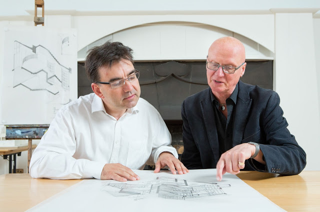 Professor George Cairns and Professor Tom Inns look at some of the special drawings donated to The GSA
